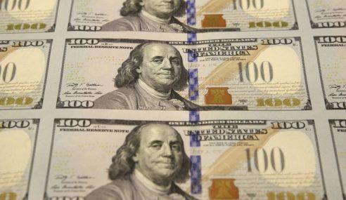 Polis Kemboja Rampas Dolar Palsu AS$7.16 Juta