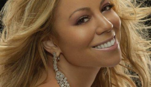 Hujan, Kebakaran & 'Lip Sync' Di Konsert Mariah Carey
