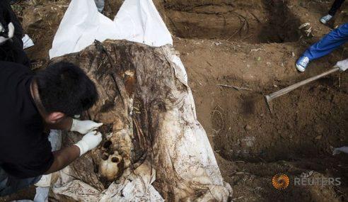 Kubur Besar Di Wang Kelian: 22 Lagi Rangka Mayat Dikeluarkan