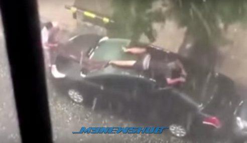 Video: Lelaki Lindungi Kereta Daripada Hujan Batu
