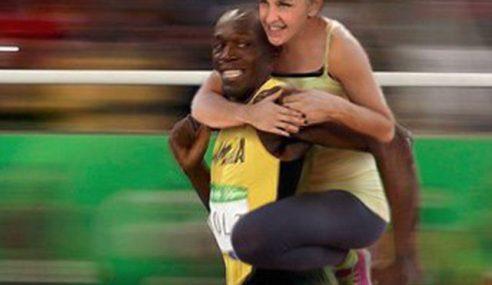 Ellen DeGeneres Dikritik Siar Foto Digendong Usain Bolt