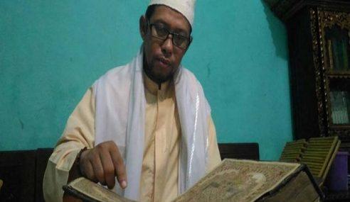 Imam Di Palembang Warisi Al-Quran Bersalut Emas