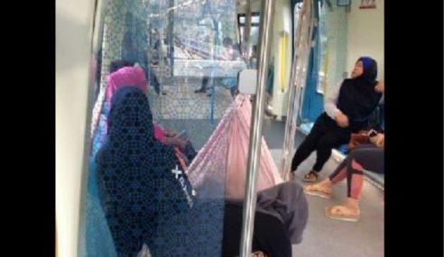 Tular Wanita Selamba Bawa Buai Anak Dalam MRT