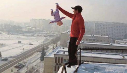 Polis Buru Bapa Gantung Bayi Di Atas Bangunan