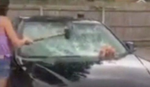 Isteri Pecahkan Kereta BMW Suami Kerana Curang