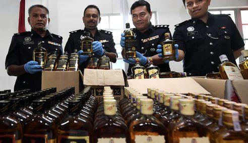 435 Botol Arak Dijual 'Kedai Belakang' Dirampas