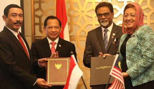Malaysia, Indonesia Tangani MoU Selesai Isu Sempadan