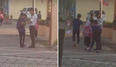 Murid Salam 'Pak Guard' Sebelum Masuk Sekolah
