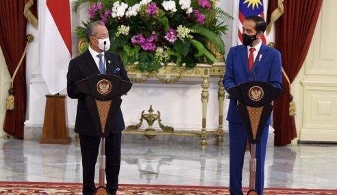 Jokowi Harap Malaysia Lindungi Pekerja Migran Indonesia